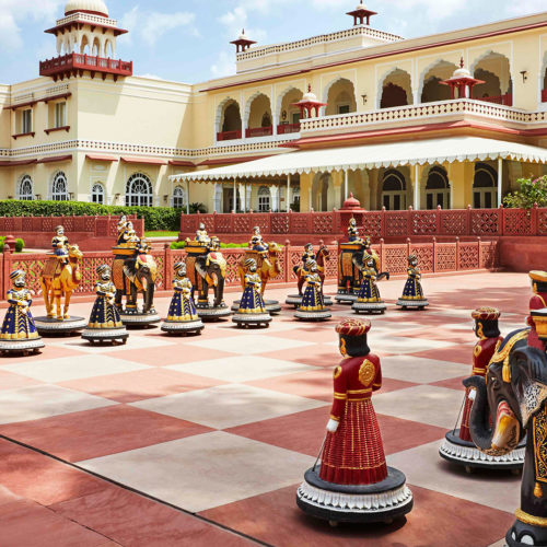 large chess pieces outside jai mahal