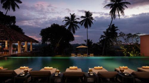 Poolside view at sunset at Kahanda Kanda hotel