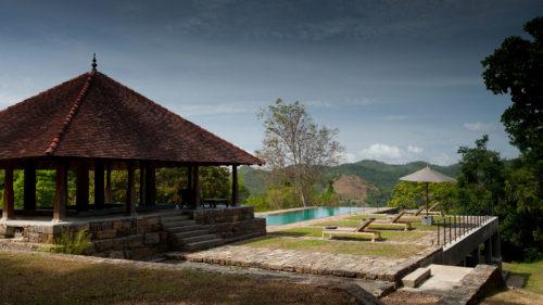 Outdoor pool and lounge area at Koslanda