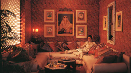 Indian woman relaxing in a traditional hotel