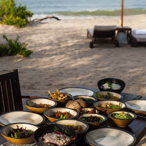A table full of food at Jungle Beach hotel