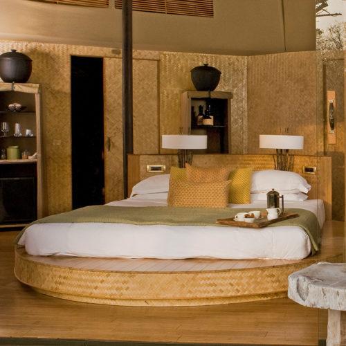 A bedroom in the Taj Manjaar Tola bedroom resort