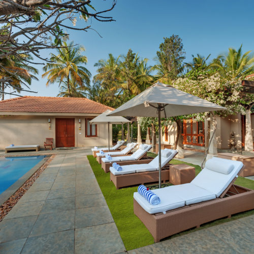 swimming pool with reclinable chairs
